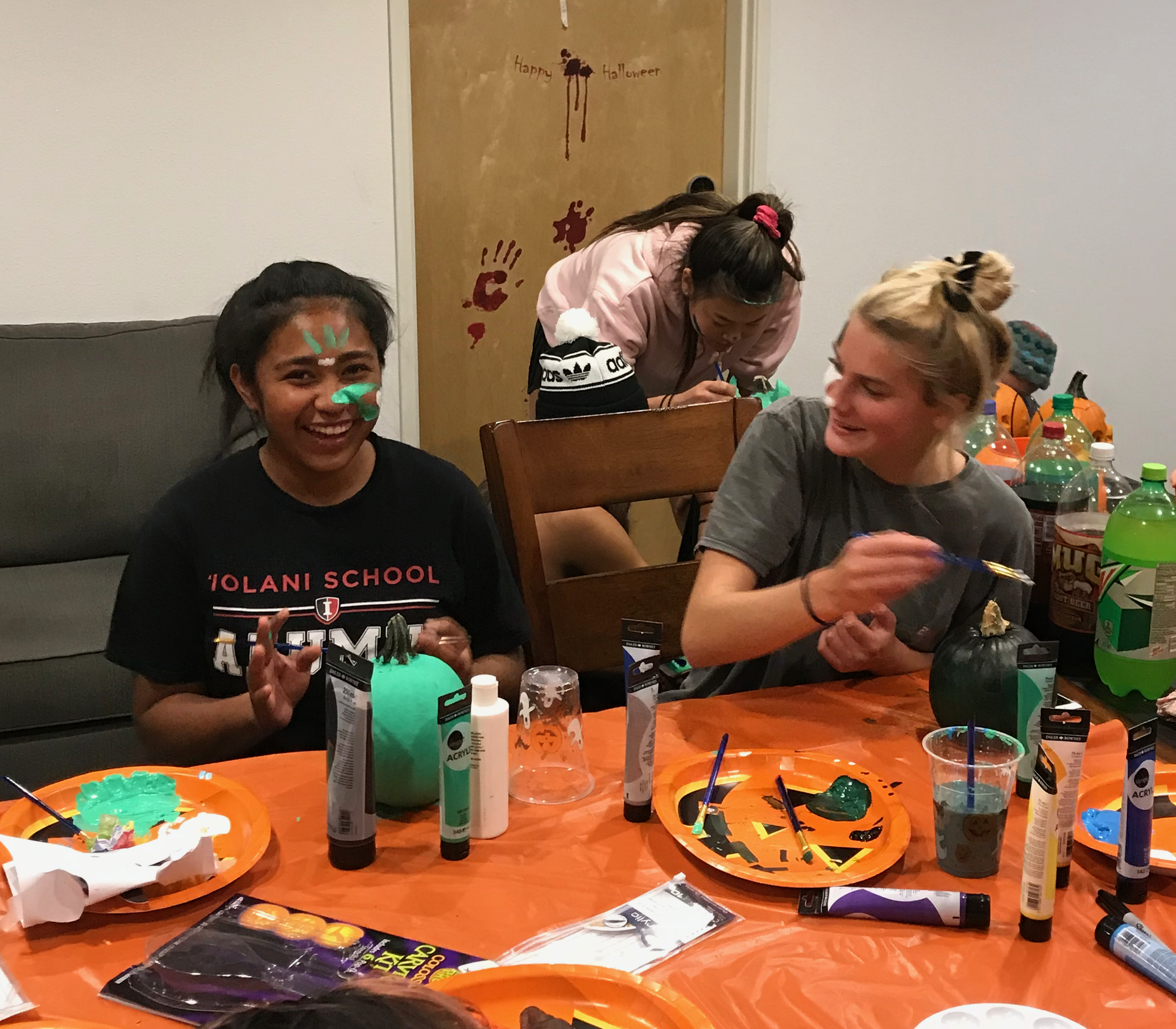 Painting faces as well as pumpkins