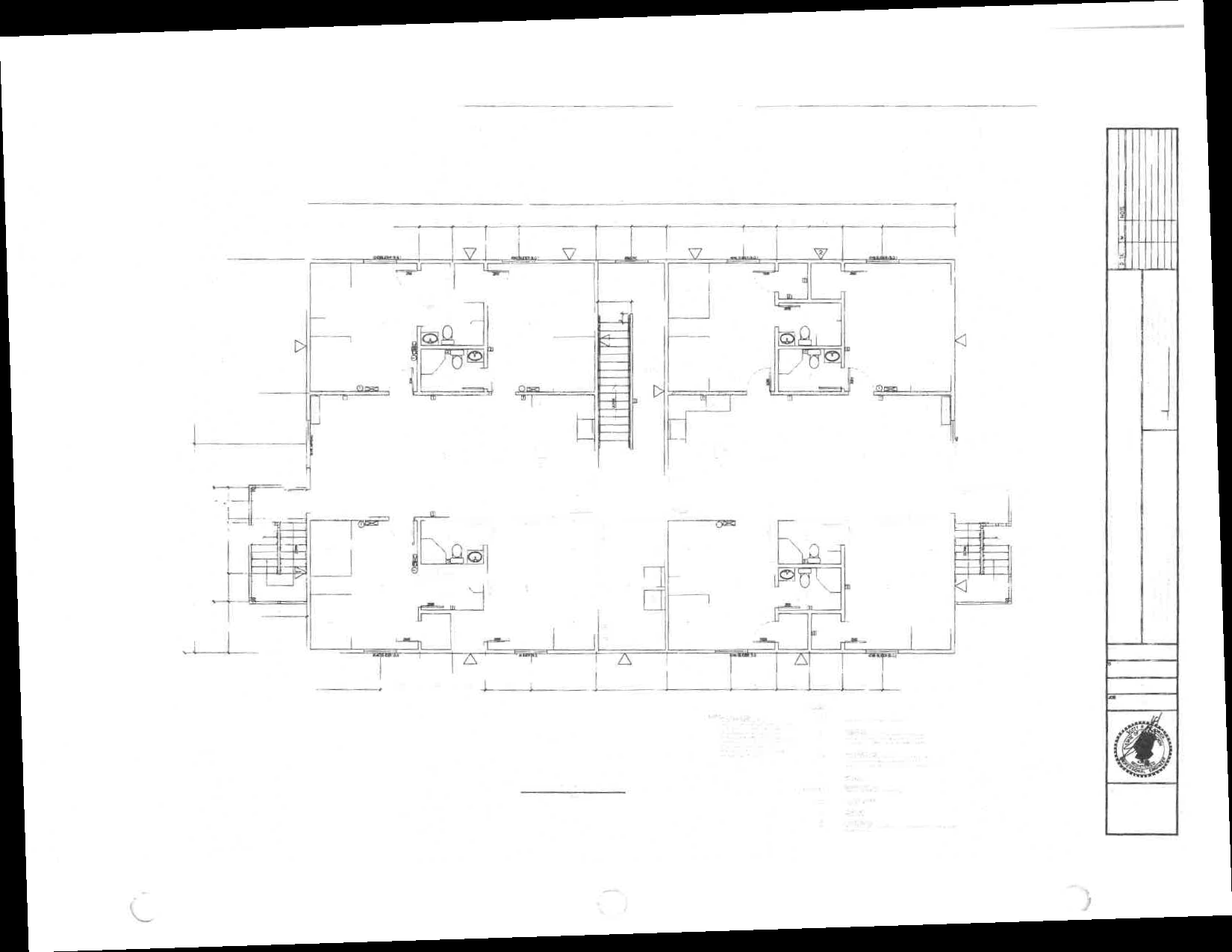 The floorplan of a typical suite, showing four bedrooms, each with a private bathroom and closet. The bedrooms share a common kitchen and living room.
